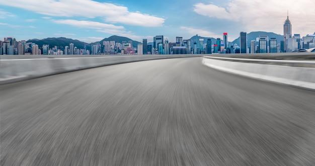 Road asphalt pavement and city  architecture   skyline