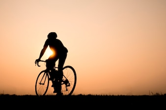 Road bike cyclist man cycling. Biking Sports fitness athlete riding bike on an open road