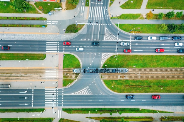 A road in the city with a top view, trams and cars are passing along the road, poland, wroclaw