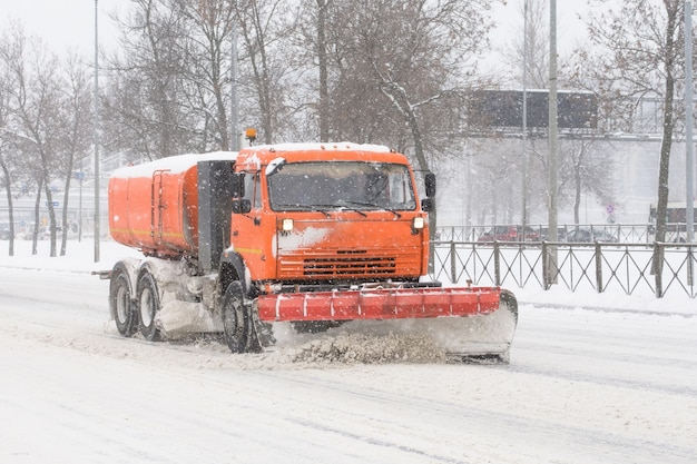 Road cleaning snow-removing machine in the city after huge snowfall.