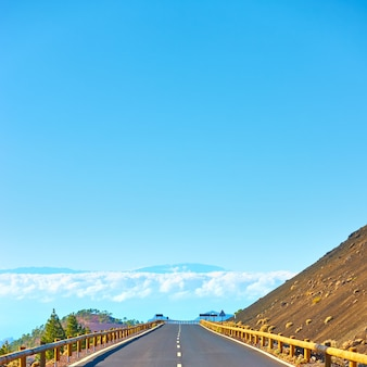 Road to the clouds - perspective highland road in teide national park, tenerife. copyspace composition