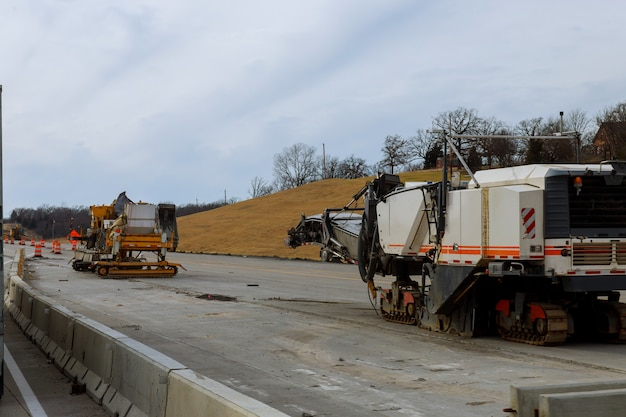 Road construction equipment are working on a new road construction repair route