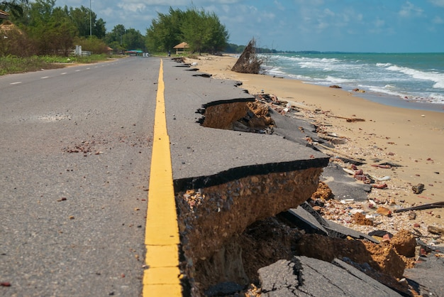 Road damage caused by sea waves erode