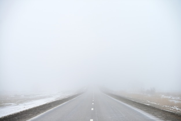 Road disappearing into the fog