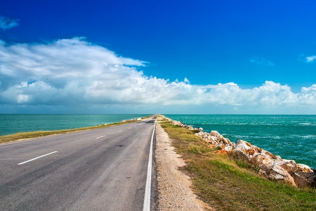 Road highway route leaving ocean bulk man-made artificial dam from island of cuba to cayo