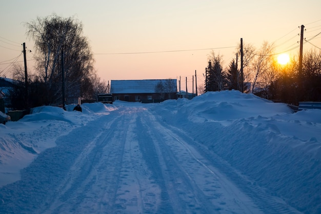 The road is all in the snow the morning sun snow removal