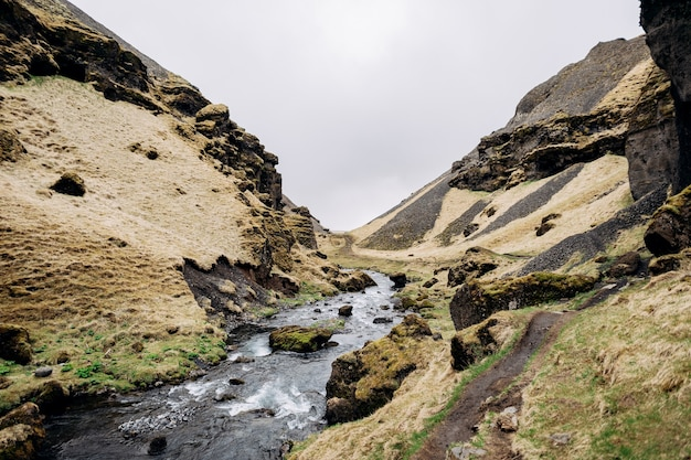 The road to the kvernufoss waterfall in the south of iceland on the golden ring mountain river in a