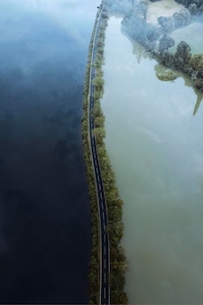 Road on a lake drone shot