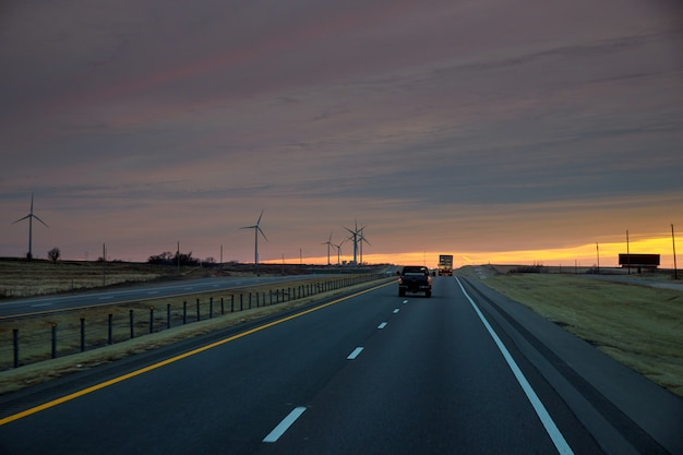 Road leading to view of the texas wind turbine farms