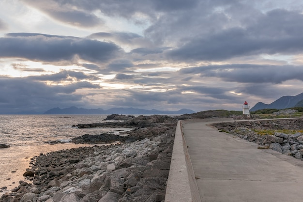 Road to the lighthouse, lofoten norway. photo taken at midnight sun