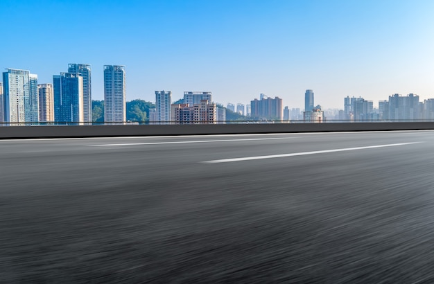 Road and modern city buildings background