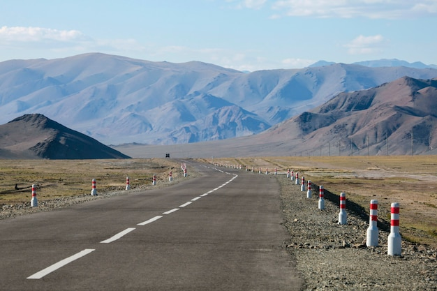 The road in mongolia, deserted mountains. traveling in asia.
