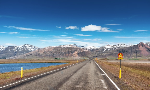 Road in mountain. bridge over a channel connecting jokulsarlon lagoon and atlantic ocean in southern iceland