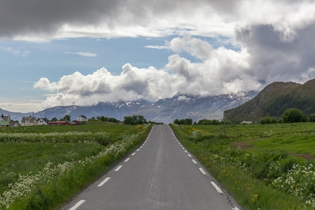 Road passing in a valley between mountains in norway