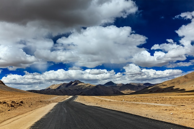 Road on plains in himalayas with mountains