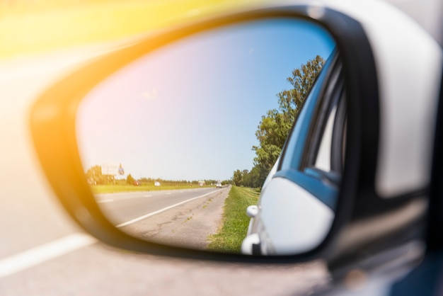 Road reflected on side mirror
