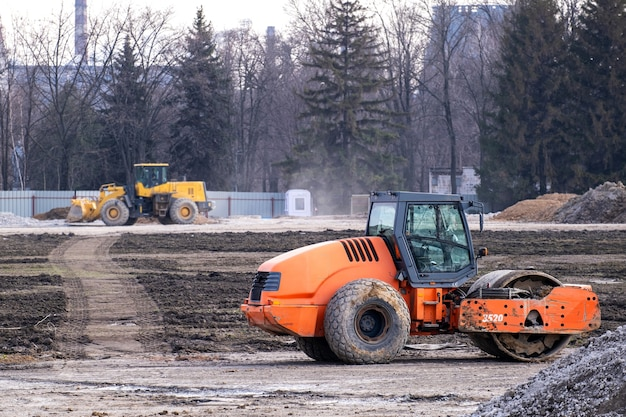 Road roller rink workig to construction of a new highway. heavy industrial machinery build a road.