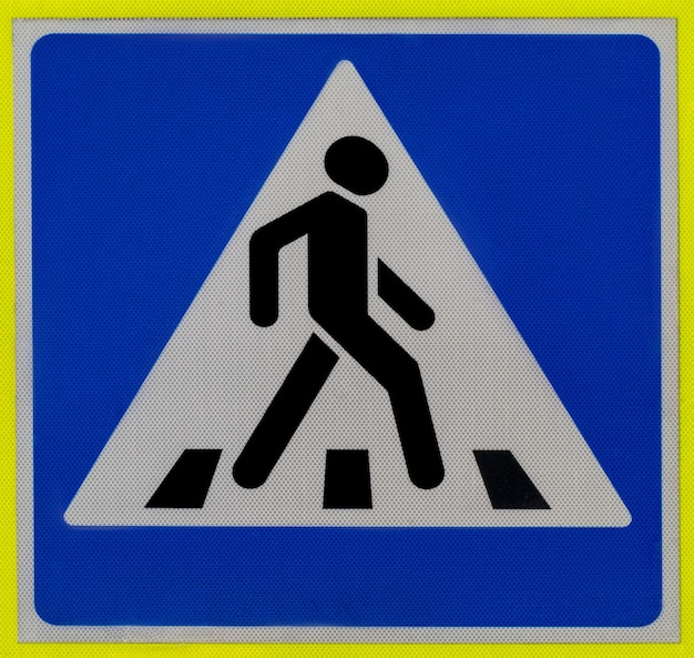Road sign   a pedestrian crossing man walking on a zebra in a triangle on a blue background