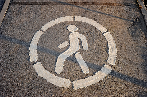 Road sign pedestrian path on the pavement