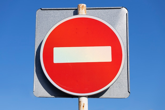 Road sign prohibiting traffic. red circle with white brick. high quality photo