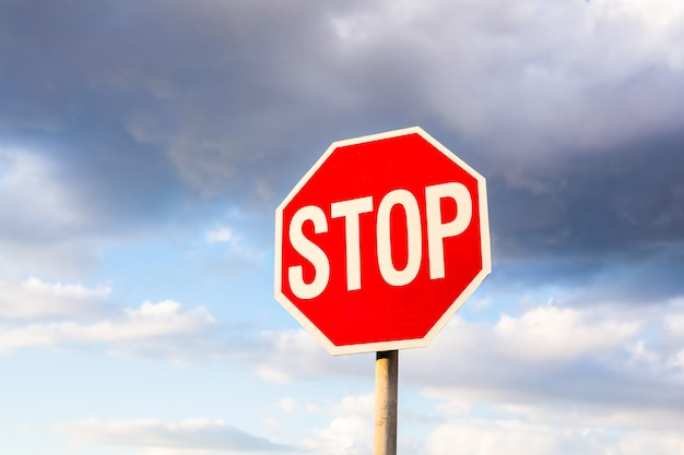 Road sign stop on a sky background