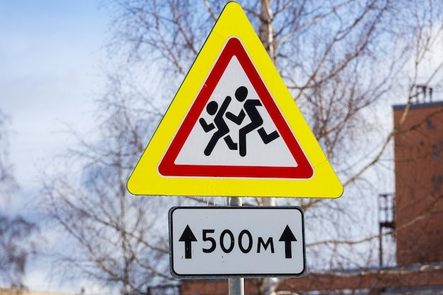 Road sign triangular shaped cautiously children. high quality photo