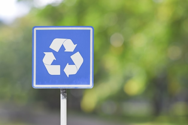 Road sign with recycle logo symbol