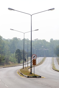 Road and sign with street lights