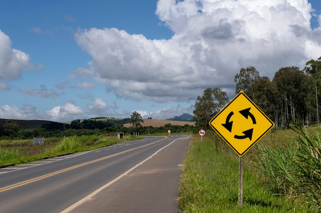 Road signs indicating roundabout on the highway