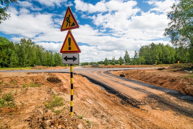 Road signs on a new road under construction