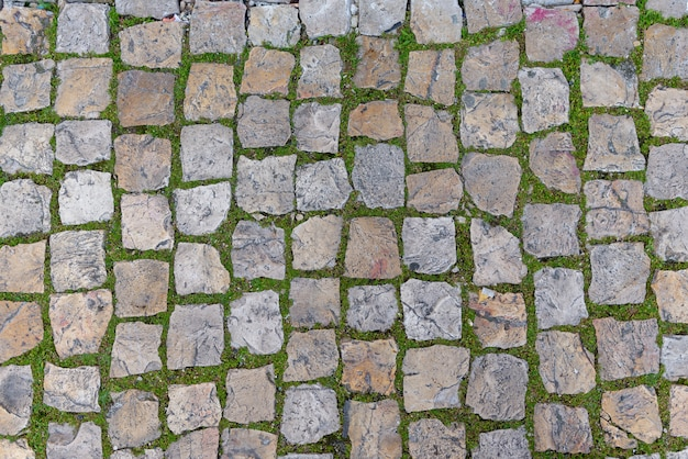 Road stone background texture, street tile texture top view