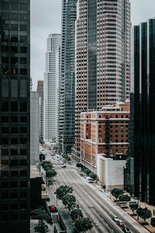Road in between tall buildings