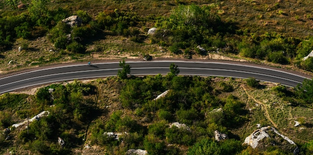 The road through the countryside. landscapes of the country. travel to beautiful places by bike. road trip the perfect road. aerial survey of the road. copy space