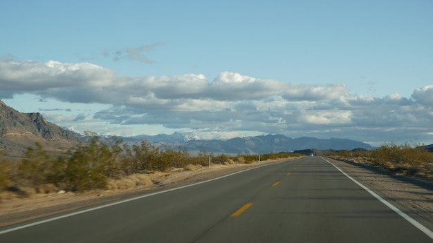 Road trip, driving auto from death valley to las vegas, nevada usa