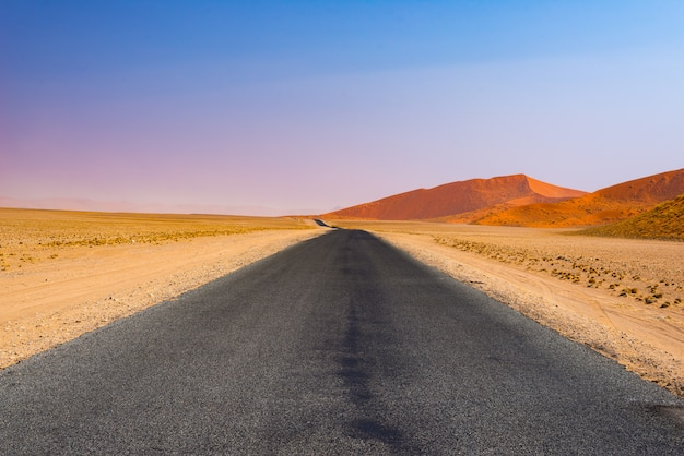 Road trip in the namib desert, namib naukluft national park, travel destination in namibia. travel adventures in africa.