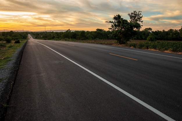 The road in the valley at the time of the sunset concept of vacation and travel