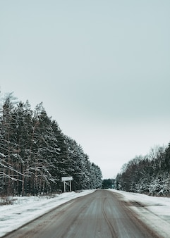 Road in winter. beautiful road by the forest. winter landscape. empty road
