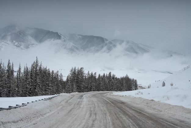 Road in winter mountains. cloudy weather.