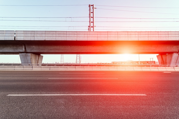 Road with flyover with sun