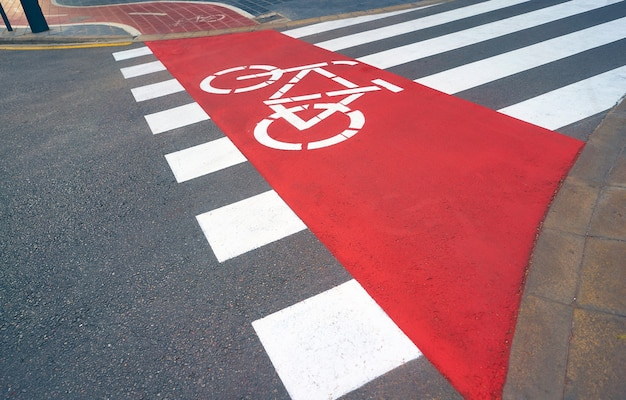 A road with freshly painted zebra crossing and bicycle lane