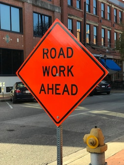 Road work ahead construction sign on the street