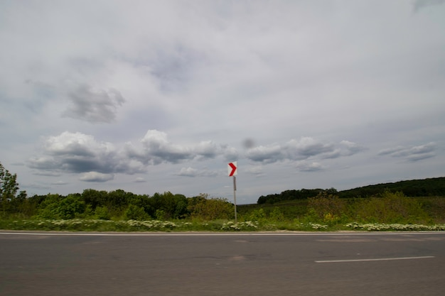 Roadside and beautiful cloudy sky in motion from the car window