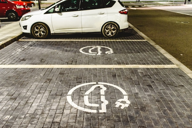 Roadsign of free electric car charging station in a european supermarket parking lot.