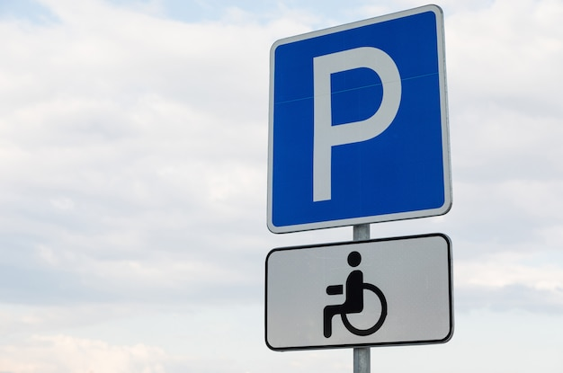 Roadsign parking lot with white tablet for handicapped