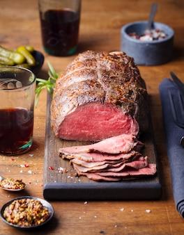 Roast beef on cutting board.