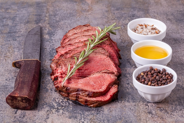Roast beef on wooden background
