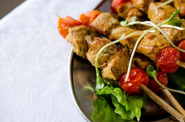 Roast chicken filet kebab on bamboo sticks