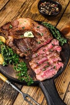 Roast rib eye beef meat steak on a cutting board
