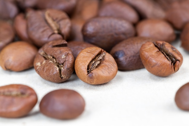 Roasted aromatic coffee beans, close-up of coffee beans for making a real drink