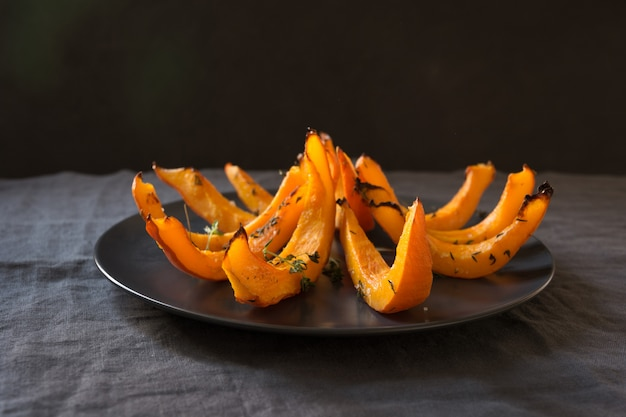 Roasted, baked pumpkin with thyme.